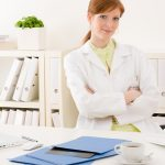 Doctor office - portrait female physician sit by desk