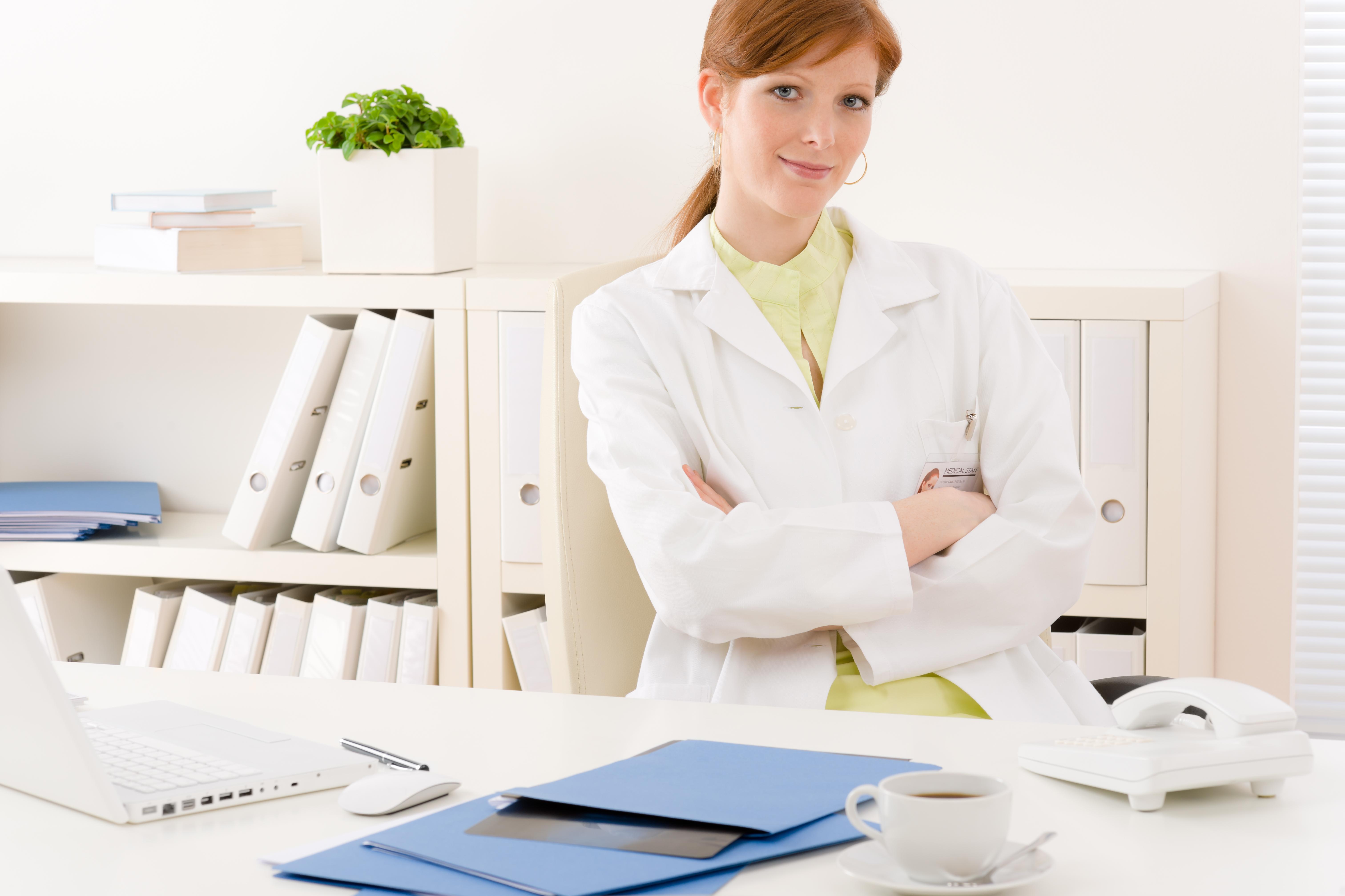 Doctor office - portrait female physician sit by desk