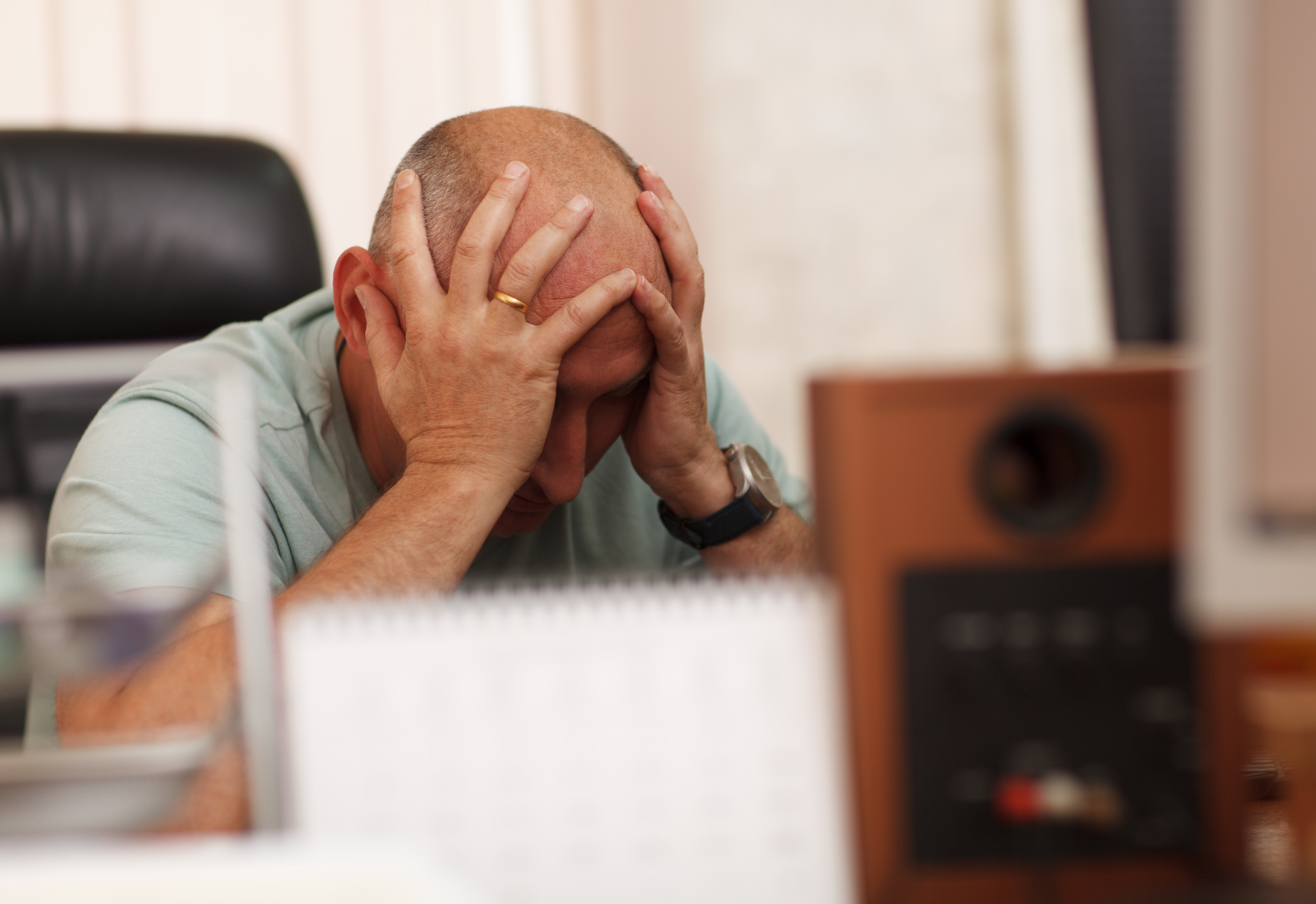 Middle-aged businessman in the office thinking about business problems